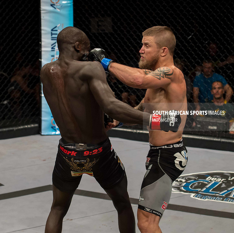JOHANNESBURG, SOUTH AFRICA - Leon Mynhardt vs. Themba Gorimbo - lightweight title bout - OCTOBER 03: during EFC 44 Fight night at the Big Top Arena, Carnival City, Johannesburg, South Africa on October 03, 2015. (Photo by Anton Geyser/ EFC Worldwide)