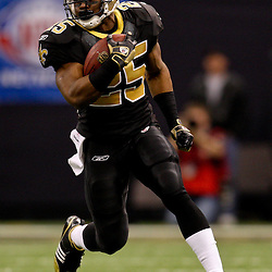 2009 December 19:  New Orleans Saints running back Reggie Bush (25) runs with the ball during a 24-17 win by the Dallas Cowboys over the New Orleans Saints at the Louisiana Superdome in New Orleans, Louisiana.