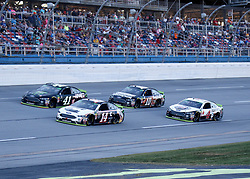 October 14, 2018 - Talladega, AL, U.S. - TALLADEGA, AL - OCTOBER 14: #14: Clint Bowyer, Stewart-Haas Racing, Ford Fusion Cummins/Rush Truck Centers,#41: Kurt Busch, Stewart-Haas Racing, Ford Fusion Monster Energy / Haas Automation,#4: Kevin Harvick, Stewart-Haas Racing, Ford Fusion Jimmy John's,#10: Aric Almirola, Stewart-Haas Racing, Ford Fusion Smithfield Bacon for Life during the runinng of the 1000Bulbs.com500 on Sunday October 14, 2018 at Talladega SuperSpeedway in Talladega Alabama (Photo by Jeff Robinson/Icon Sportswire) (Credit Image: © Jeff Robinson/Icon SMI via ZUMA Press)