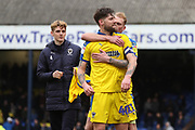 AFC Wimbledon midfielder Anthony Wordsworth (40), AFC Wimbledon Jack Rudoni (42), and AFC Wimbledon midfielder Mitchell (Mitch) Pinnock (11) celebrating during the EFL Sky Bet League 1 match between Southend United and AFC Wimbledon at Roots Hall, Southend, England on 16 March 2019.