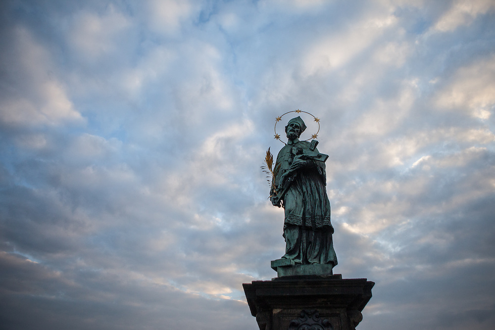 The St. John of Nepomuk Statue at Charles Bridge during early morning.