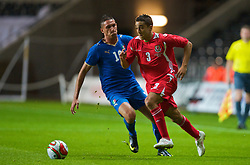SWANSEA, ENGLAND - Friday, September 4, 2009: Wales' Neil Taylor and Italy's Federico Macheda during the UEFA Under 21 Championship Qualifying Group 3 match at the Liberty Stadium. (Photo by David Rawcliffe/Propaganda)