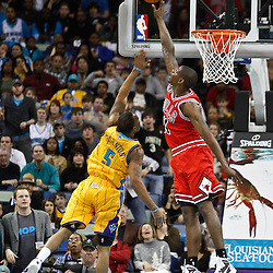 February 12, 2011; New Orleans, LA, USA; Chicago Bulls shooting guard Ronnie Brewer (11) blocks a shot by New Orleans Hornets guard Marcus Thornton (5) during the fourth quarter at the New Orleans Arena.  The Bulls defeated the Hornets 97-88. Mandatory Credit: Derick E. Hingle