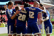 Brentford Players congratulate Brentford defender Nico Yennaris after scoring during the Sky Bet Championship match between Nottingham Forest and Brentford at the City Ground, Nottingham, England on 2 April 2016. Photo by Chris Wynne.
