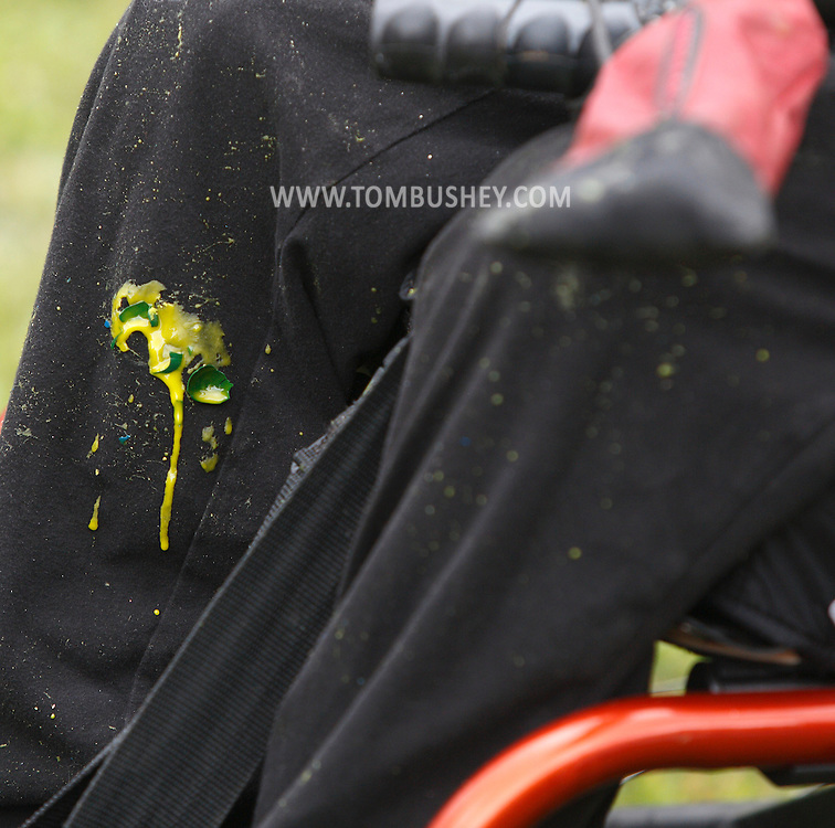 Paint drips on Simone Farran's leg after a game of paintball at the Montgomery Sporting Goods paintball fields in the Town of Wallkill on Saturday, Sept. 21, 2013. Farran, from Middletown, plays with and against other players in wheelchairs in a program organized by Royce Burns of New Life Van Auto and Truck Modifications.