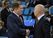 Nov 15, 2019; Los Angeles, CA, USA; UNLV Rebels head coach T.J. Otzelberger (left) shakes hands with UCLA Bruins head coach Mick Cronin during the game at Pauley Pavilion. UCLA defeated UNLV 71-54.