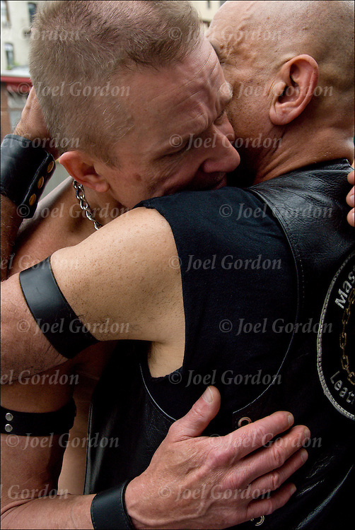 """Folson Street East S&M Fair in New York City. Master / Slave Cathartic Flogging scene.The flogging brings out a release of emotions usually by a crying. Hugging is the """"aftercare"""" where the slave feels safe and protected.."""
