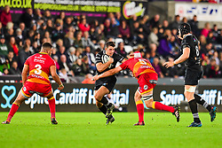 Ospreys' Owen Watkin is tackled by Dragons' Cory Hill - Mandatory by-line: Craig Thomas/JMP - 27/10/2017 - RUGBY - Liberty Stadium - Swansea, Wales - Ospreys v Dragons - Guinness Pro 14