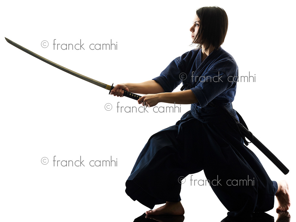 one caucasian woman practicing laido Katori Shinto ryu shadow silhouette isolated on white background
