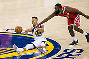 Golden State Warriors forward Kevin Durant (35) steals the ball from Houston Rockets guard James Harden (13) at Oracle Arena in Oakland, Calif., on October 17, 2017. (Stan Olszewski/Special to S.F. Examiner)