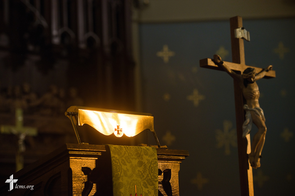 The pulpit is bathed in evening light next to a crucifix near the altar at Trinity Lutheran Church on Wednesday, July 15, 2015, in Danville, Ill. LCMS Communications/Erik M. Lunsford