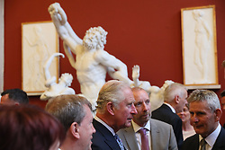 The Prince of Wales (centre) talks with guests as he attends a dinner at Crawford Art Gallery as part of his tour of the Republic of Ireland with the Duchess of Cornwall. PRESS ASSOCIATION Photo. PRESS ASSOCIATION Photo. Picture date: Thursday June 14, 2018. See PA story ROYAL Charles. Photo credit should read: Brian Lawless/PA Wire