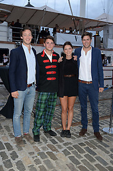 Johnnie Walker Gold Label Reserve Finale Celebration Party aboard the John Walker & Sons Voyager moored at the Prince of Wales Docks, Leith, Edinburgh, Scotland on 14th August 2013.<br /> Picture shows:-Left to right,William Ayles, Archie Kelly, Kate Parry-Crooke and Lord Tommy Fitzalan-Howard.