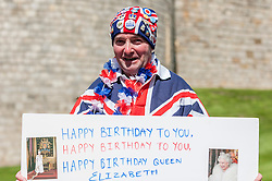 © Licensed to London News Pictures. 20/04/2016. Windsor, UK. John Loughrey, 61, with a birthday card, is one of the keen royal fans who will camp out overnight in order to be in prime position in order to see The Queen as she takes part in a walkabout outside Windsor Castle tomorrow her 90th birthday tomorrow.  Photo credit : Stephen Chung/LNP