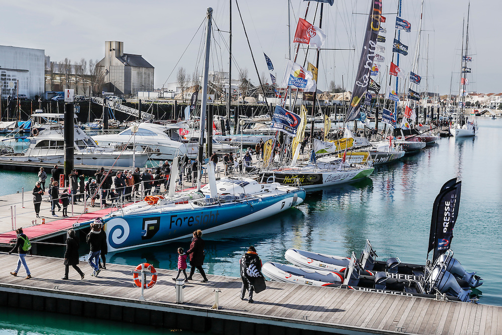 New Zealand sailor Conrad Colman on his boat the day after he crossed the Vendee Globe Race finish line in Sables d'Olonne.  Conrad's Foresight boat at dock in Sable d'Olonne marina. With his half mast size. 25 February 2017.
