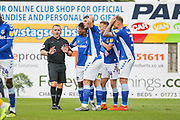 Oldham Athletic players appeal to the referee during the EFL Sky Bet League 2 match between Mansfield Town and Oldham Athletic at the One Call Stadium, Mansfield, England on 12 October 2019.
