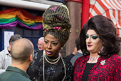 London, UK. 30th April 2019. Members of the LGBTQ community join survivors of the Admiral Duncan bombing and families and friends of the victims outside the Admiral Duncan pub in Old Compton Street, Soho, to mark 20 years since the attack. Three people were killed and 79 injured when a bomb packed with up to 1,500 four-inch nails was detonated by a neo-Nazi at the Admiral Duncan on 30th April 1999.