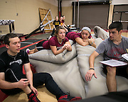 Alex Caldwell, second from left, at track practice at St. John Fisher College on Friday, November 7, 2014.