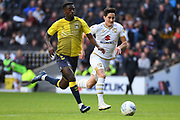 Coventry City striker Jordi Hiwula-Mayifuila  (11) chases down the ball with Milton Keynes Dons defender George Williams (2) during the EFL Sky Bet League 1 match between Milton Keynes Dons and Coventry City at stadium:mk, Milton Keynes, England on 19 October 2019.