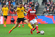 Romain Saiss (27) of Wolverhampton Wanderers tackles Jay Dasilva (3) of Bristol City during the The FA Cup 5th round match between Bristol City and Wolverhampton Wanderers at Ashton Gate, Bristol, England on 17 February 2019.