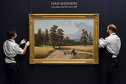 "© Licensed to London News Pictures. 03/06/2016. London, UK. Sotheby's staff hang Ivan Shiskin's ""At the edge of the pine forest"" (est. GBP 500,000-700,000), at a preview of Sotheby's Russian and contemporary central and eastern European art sale which takes place in London on 7 June. Photo credit : Stephen Chung/LNP"