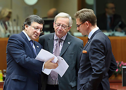 Jean-Claude Juncker, Luxembourg's prime minister, center, speaks with Jose Manuel, Barroso, president of the European Commission, left, and Mari Kiviniemi, Finland's prime minister, right,  during an emergency EU Summit to solve Europe's debt crisis at the European Council headquarters in Brussels, Belgium, on Wednesday, Oct. 26, 2011. (Photo © Jock Fistick)