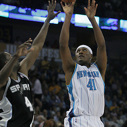17 December 2008: New Orleans Hornets forward James Posey (41) shoots over San Antonio Spurs guard Michael Finley (4) during a NBA regular season game between the Western Conference rivals the San Antonio Spurs and the New Orleans Hornets at the New Orleans Arena in New Orleans, LA..