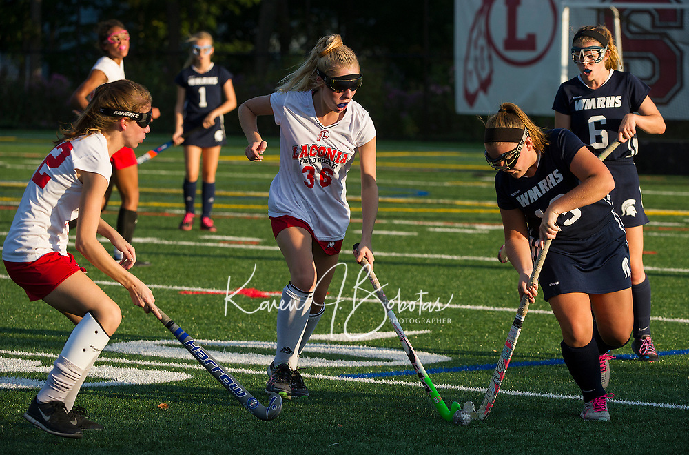 Laconia's 36/Howland and White Mountain's 13/Glidden go for control of the ball during NHIAA Division III Field Hockey on Wednesday afternoon.  (Karen Bobotas/for the Laconia Daily Sun)