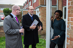 © Licensed to London News Pictures . 17/11/2014 . Kent , UK . UKIP candidate Mark Reckless (centre) with UKIP deputy leader Paul Nuttall (left) canvassing votes in Strood in the Rochester and Strood by-election . They meet Fatima Macaulay (right) who says she's voting UKIP . Photo credit : Joel Goodman/LNP