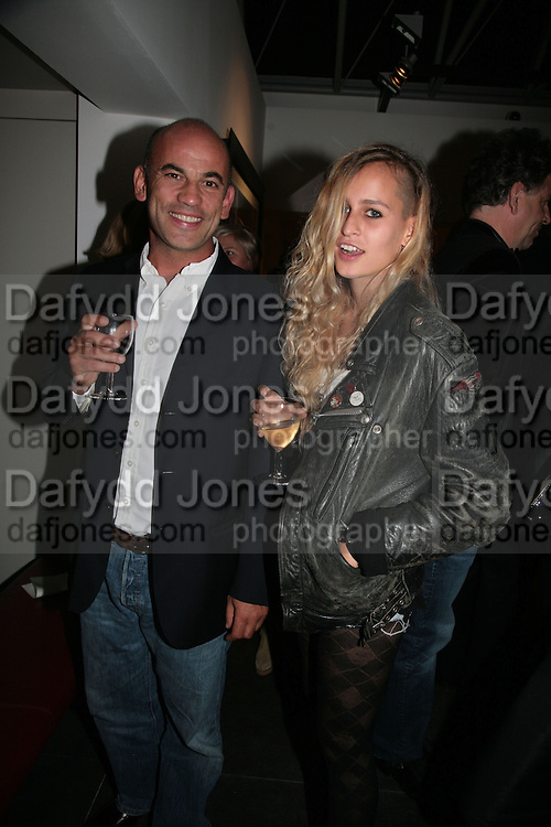 GUY DELLAL AND HIS DAUGHTER ALEX DELLAL, Helmut Newton XL. Hamiltons. Carlos Place. London. 25 September 2007. -DO NOT ARCHIVE-© Copyright Photograph by Dafydd Jones. 248 Clapham Rd. London SW9 0PZ. Tel 0207 820 0771. www.dafjones.com.