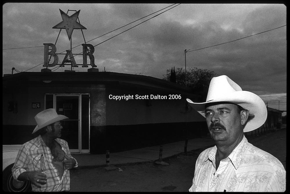 Two Americans on the streets of Boystown, in Nuevo Laredo Mexico, just across the US-Mexico border from Laredo, Texas. Boystown is a walled community, only one way in or out, which is home to the cities prostitution and red light bars. Many of the prostitutes who work there are transsexuals and transvestites. The idea behind the walled community is to isolate the activities associated with red light districts. (Photo/Scott Dalton)