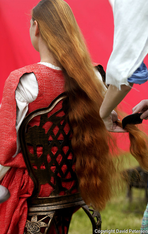 RAPUNZEL, LET DOWN YOUR HAIR - Dame Isabean dela ' Reve, the VisCountess of Andorra, has her long red hair brushed before it is braided Sunday at the Renassaince Faire at the Iowa State Fairgrounds in Des Moines, Ia.