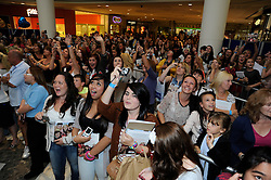 "© Licensed to London News Pictures. 15/09/2011.Lakeside,Essex, UK.One Direction at Lakeside,Essex to sign copies of their new book ""Dare to Dream"".  Liam, Harry, Zayn, Louis and Niall showed off the new book at   Lakeside's Central Atrium today (15.09.2011).Fans going crazy.Photo credit : Grant Falvey/LNP"
