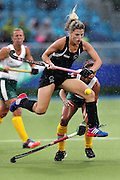 Gemma Flynn of New Zealand in action during the bronze medal match between New Zealand and South Africa. Glasgow 2014 Commonwealth Games. Hockey, Bronze Medal Match, Black Sticks Women v South Africa, Glasgow Green Hockey Centre, Glasgow, Scotland. Saturday 2 August 2014. Photo: Anthony Au-Yeung / photosport.co.nz