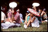 Japanese family seated on grass enjoying performance at Japanese Festival;Mo Botanical Garden,StL Missouri