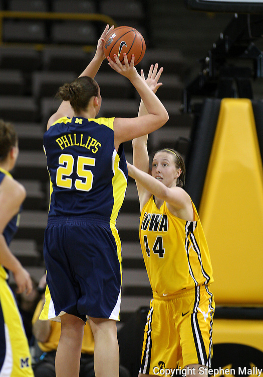 26 JANUARY 2009: Michigan center Krista Phillips (25) puts up a shot over Iowa center Megan Skouby (44) during the first half of an NCAA women's college basketball game Monday, Jan. 26, 2009, at Carver-Hawkeye Arena in Iowa City, Iowa. Iowa defeated Michigan 77-69.
