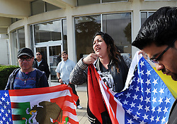 Protestors including Ana Barrerra, holding flag, and Juan Carlos Gonzales, left, made their voices heard outside City Hall on Tuesday after a fatal, officer-involved shooting close to the Sanborn Plaza Market in east Salinas.