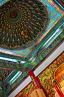 Colourful temple art depicting gods and ancient stories adorn the walls, doors and domed roof of Thean Hou Temple in Kuala Lumpur.