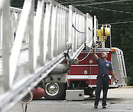 Opelika firefighter Noah Allmond and fellow firefighters  clean and oil up the ladder on one of their trucks as part of routine maintnence Tuesday at Opelika station 3.  Photo by Elliot Knight