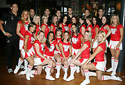 """Warriors players pose for a photo with the Vodafone Cheerleaders during the launch of Sky 1's Reality Series """"The Cheerleaders"""" at the Northern Steamship Co. Auckland, Tueaday 20 March 2007. Photo: Andrew Cornaga/PHOTOSPORT<br /> <br /> <br /> 200307"""