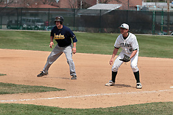 12 April 2014:  Nick Hahn tends first base during an NCAA division 3 College Conference of Illinois and Wisconsin (CCIW) baseball game between the Augustana Vikings and the Illinois Wesleyan Titans at Jack Horenberger Stadium, Bloomington IL