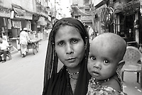 Woman and her child on the streets of Old Delhi, India