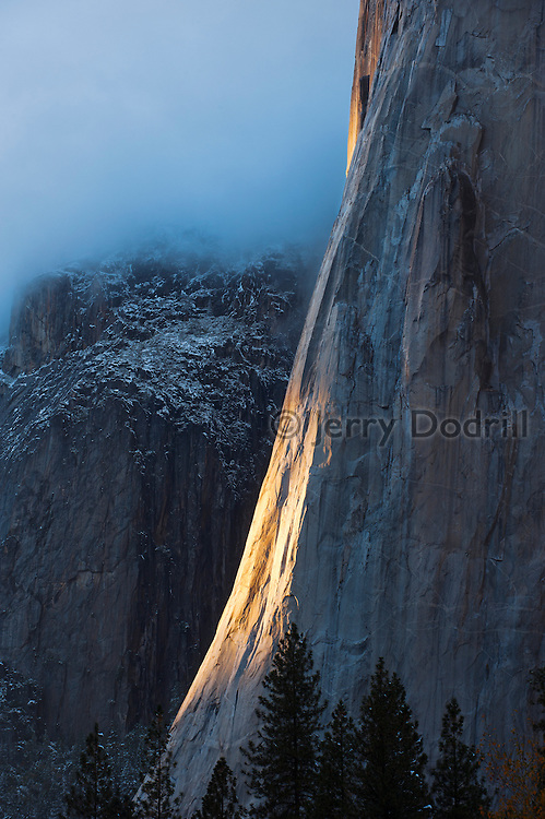 The Nose of El Capitan in evening light during an autumn snow storm in Yosemite National Park, California
