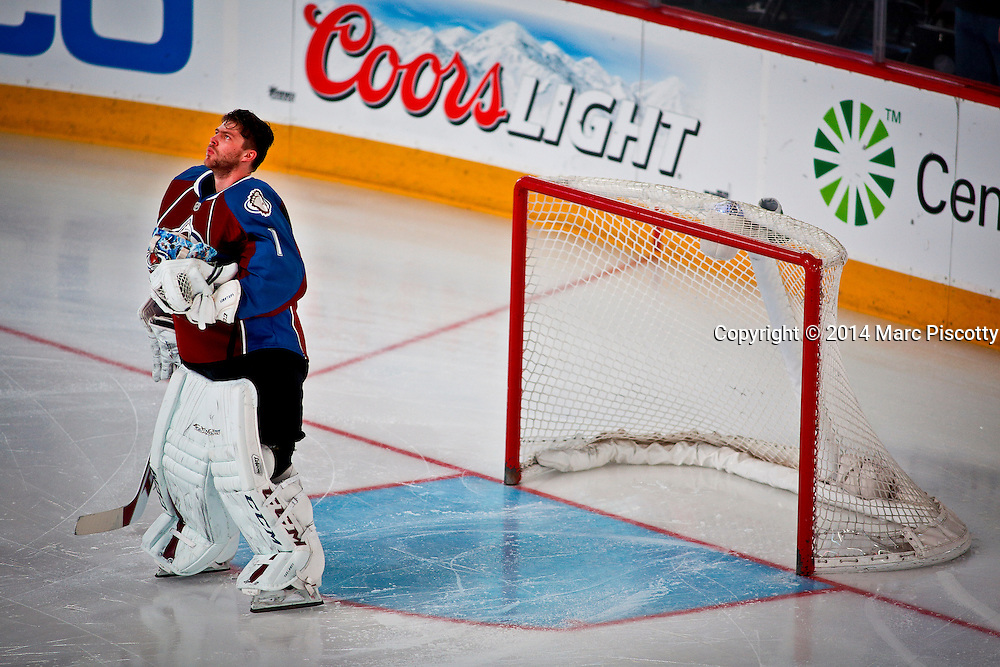 SHOT 3/8/14 2:01:58 PM - Colorado Avalanche goaltender Semyon Varlamov #1 watches the video screen as the National Anthem is played before facing the St. Louis Blues during their regular season Western Conference game at the Pepsi Center in Denver, Co. The Blues won the game 2-1.<br /> (Photo by Marc Piscotty / &copy; 2014)