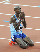 Athletics - 2017 IAAF London World Athletics Championship - Day Thirteen, Evening Session<br /> <br /> Men's 5000m Final<br /> <br /> Mo Farah of Great Britain drops to his knees after the race at the London Stadium.<br /> <br /> COLORSPORT/ANDREW COWIE