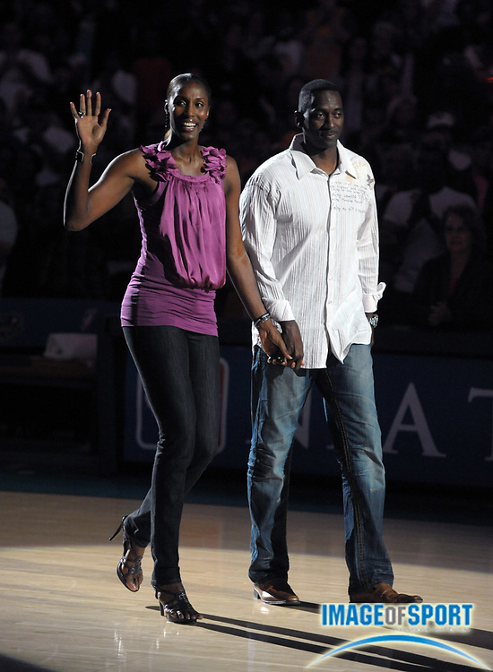 Aug 10, 2010; Los Angeles, CA, USA; Los Angeles Sparks former player Lisa Leslie (right) is accompanied by her husband Michael Lockwood during a halftime ceremony to retire the No. 9 jersey of Leslie during the WNBA game against the Indiana Fever at the Staples Center. Photo by Image of Sport