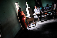 A woman walks away after casting her vote at a polling station during the second phase of voting in parliamentary elections April 23, 2009 in the Muslim dominated town of Mukalmua in the state of Assam, India. Polling took place amid tight security after several acts of militant violence in recent days.