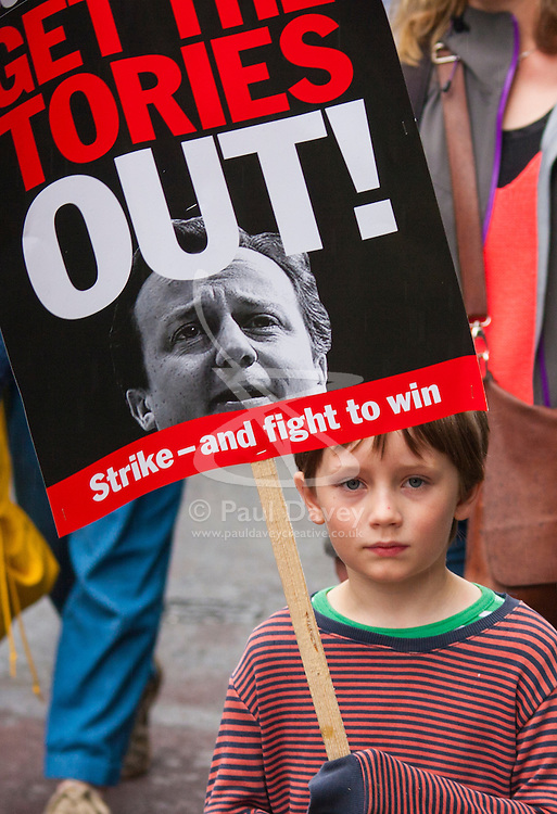 London, July 10th 2014. Many children supported their parents as thousands of striking teachers, government workers and firefighters marched through London in protest against cuts and working conditions.