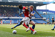 Tom Lees of Sheffield Wednesday challenges Famara Diédhiou of Bristol City during the EFL Sky Bet Championship match between Sheffield Wednesday and Bristol City at Hillsborough, Sheffield, England on 22 April 2019.
