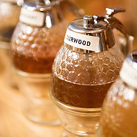 """Sampling honey such as sourwood flavor at the """"honey bar"""" in Asheville Bee Charmer, a locally owned company that offers honey and honey-related products at their store on 38 Battery Park Ave in Downtown Asheville, North Carolina."""